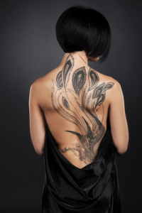 beautiful young lady with back tattoo.
